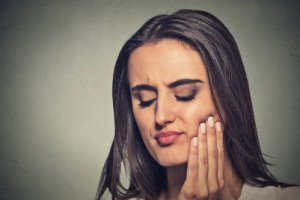woman with sensitive toothache crown problem